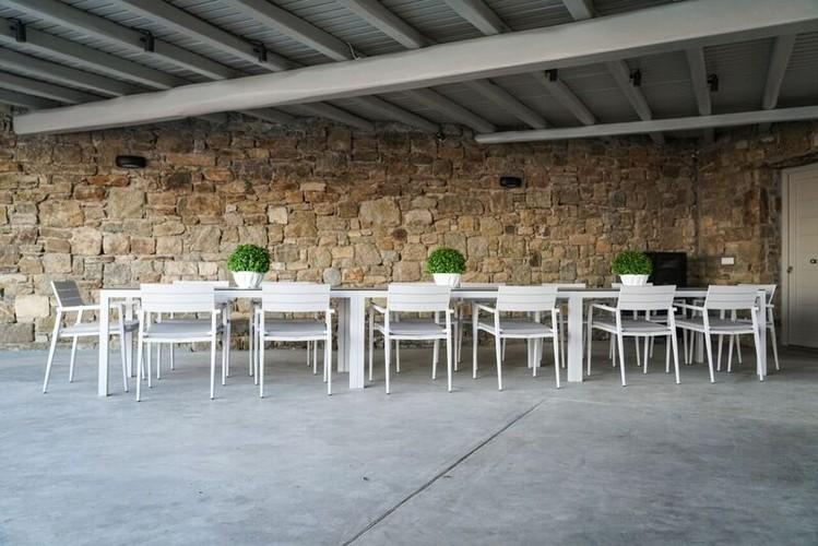 outdoor dining area with tables and chairs in the same color