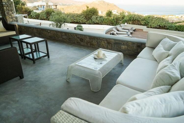 Villa_Gene_54-1.jpg Kalafatis Mykonos Outdoor Living area, bed, pillows, candle, table, climbers, towels