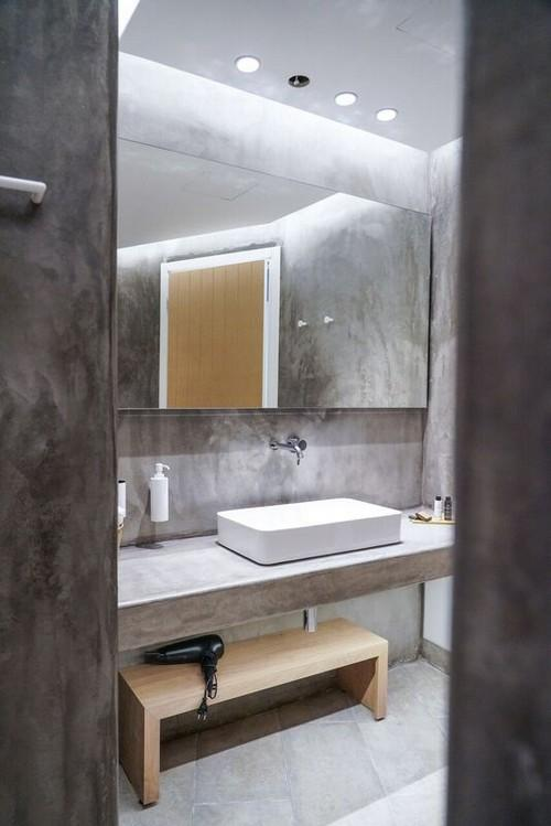 bathroom with wall lamps and bench for fan