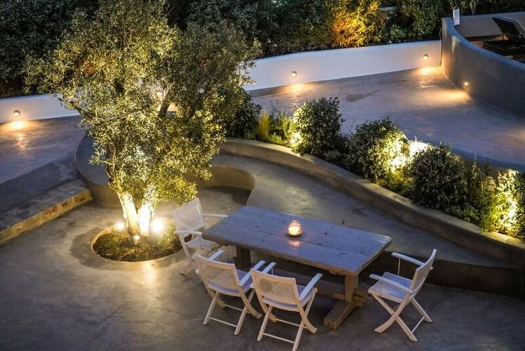beautiful lit outdoor area with green surface