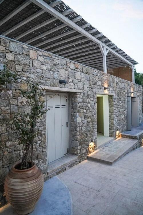 outdoor area with wall lamps and vase