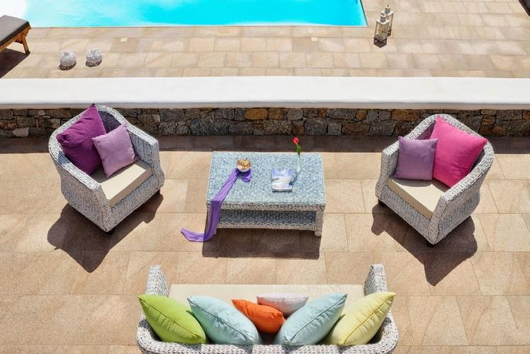 outdoor area with comfort chairs and soft pillows