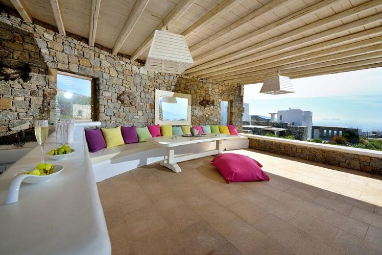 outdoor living area with soft bench and colored pillows