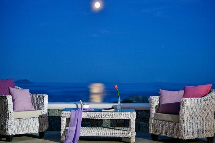 outdoor living area with a glorious view of the moon