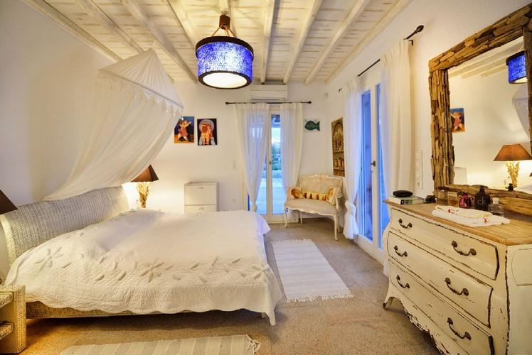 bedroom with comfort bed and old designed wooden cabin