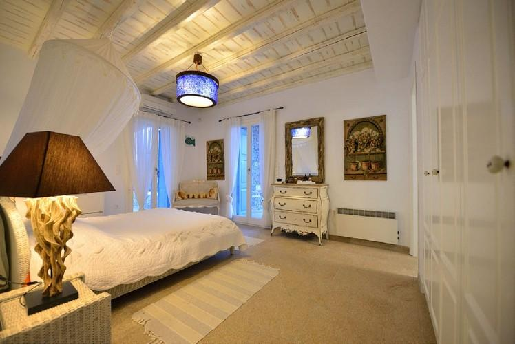 nice lit bedroom with huge white cabins and cozy bed