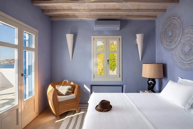Villa_Jolly_28.jpg Agios Lazaros Mykonos 1st Bedroom, bed, pillows, hat, carpet, chair, lamp, night table, air condition