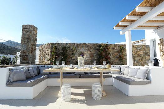 Villa_Lenard_13.jpg Panormos Mykonos Outdoor Dining area, table, bed, pillows, glass, roof, sky