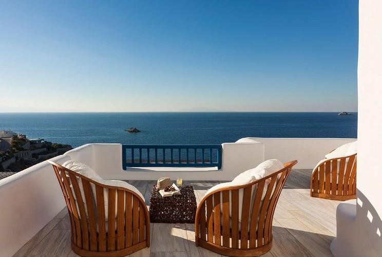 balcony with wooden comfortable white chairs