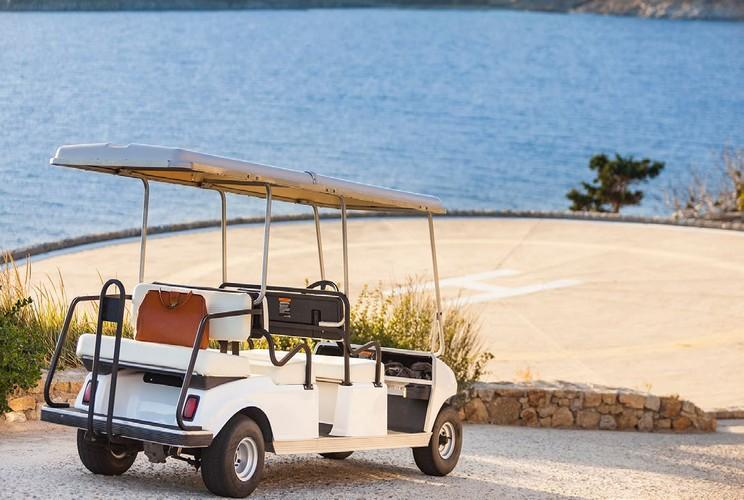 outside with golf cart and private helipad