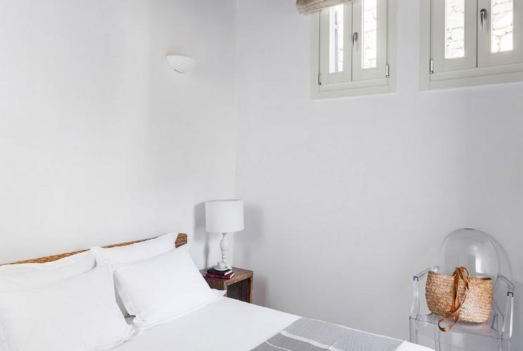 bedroom with white lamp and transparent chair