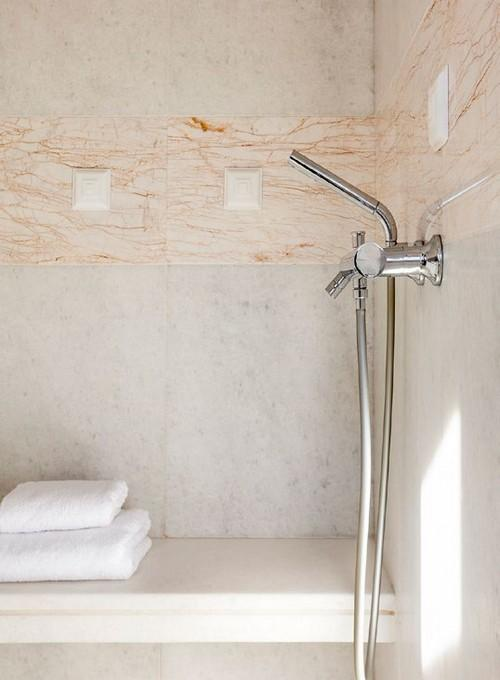 bathroom with tiled wall and soft towels