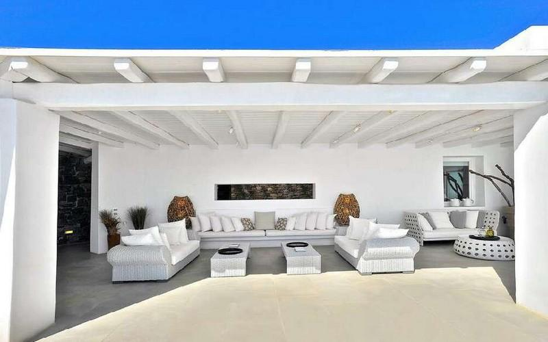 Villa_Nadine_06.jpg Houlakia Mykonos Outdoor Living area, bed, pillows, table, roof