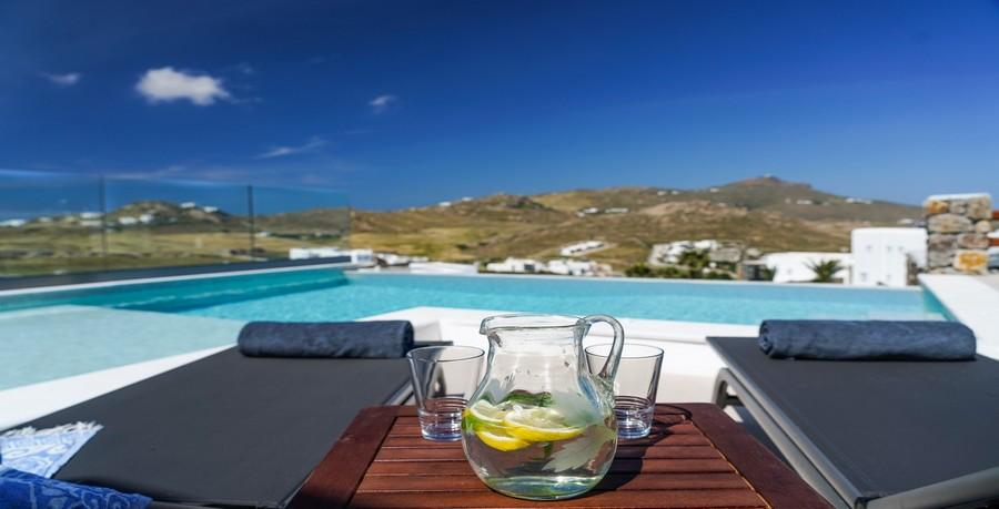 Villa_Sofy_06.jpg Kalafatis Mykonos Outdoor, water, pool, glass, climbers, towels, hill, sky