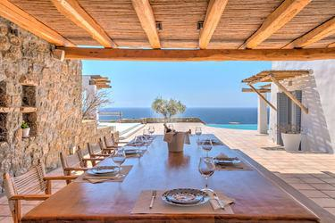 Villa_Stavros_08.jpg Lia Mykonos Outdoor Dining area, table, plate, glass, chairs, roof, sea, sky, horizon