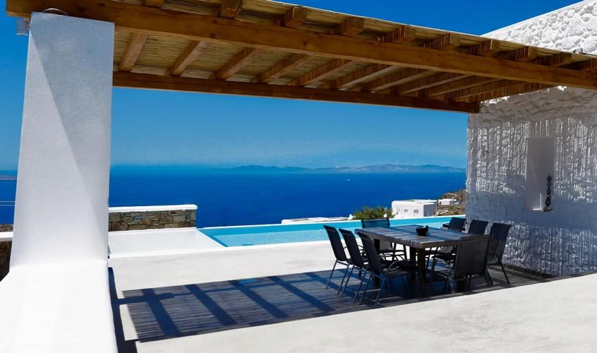 Villa_Yanni_13.jpg Fanari Mykonos Outdoor, roof, table, chairs, sea, sky, hill, pool