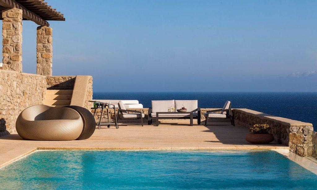Villa-Agda_06.jpg Agios Ioannis Mykonos, outdoor, pool, sea, chairs, sofa, table, fruits, bowl