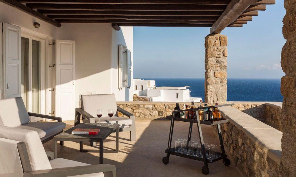 Villa-Agda_16.jpg Agios Ioannis Mykonos, outdoor, armchairs, table, glasses, wine, drinks, sea