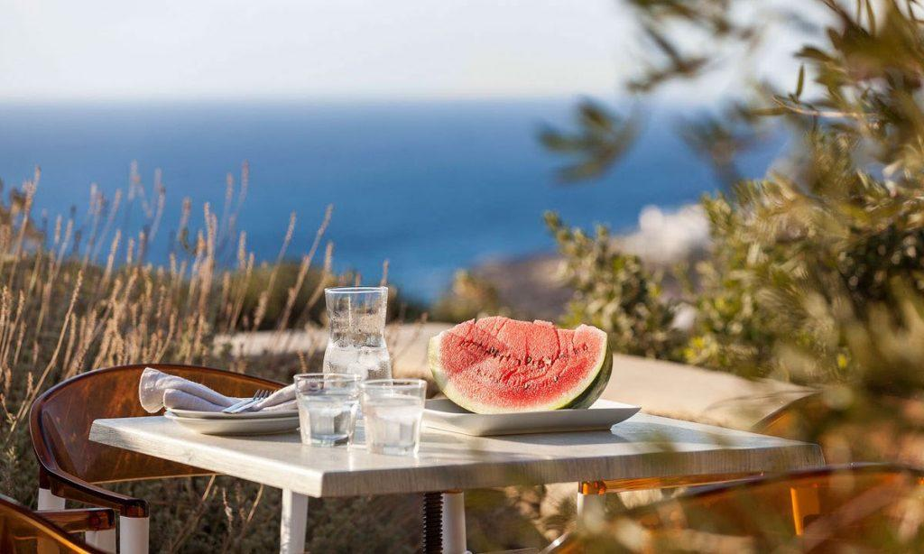 Villa-Agda_17.jpg Agios Ioannis Mykonos, outdoor, chairs, table, water, watermelon, sea
