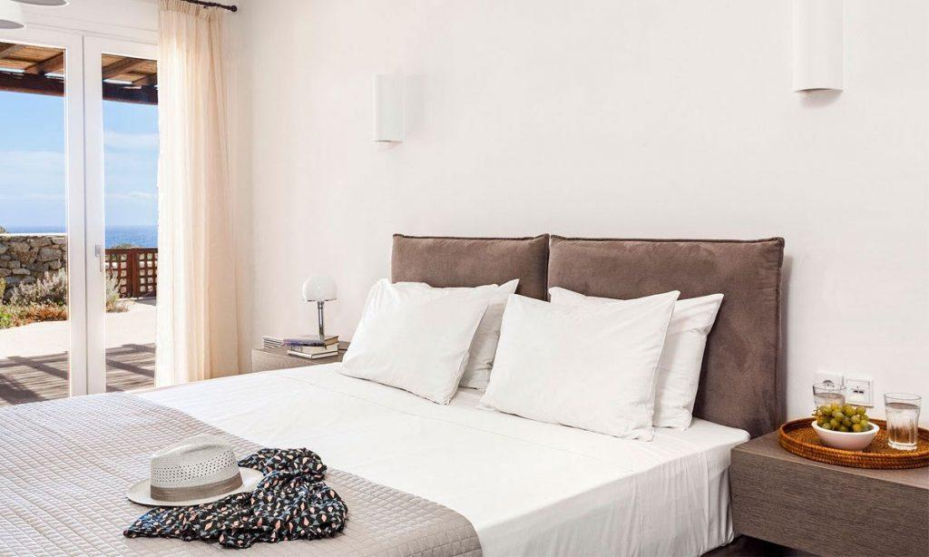 Villa-Agda_34.jpg Agios Ioannis Mykonos, 3rd bedroom, double bed, nightstand, hat, blanket, lamp
