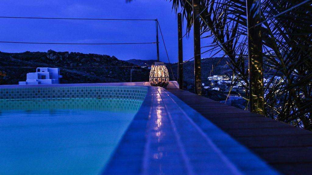 outdoor area with candle on the edge of the pool