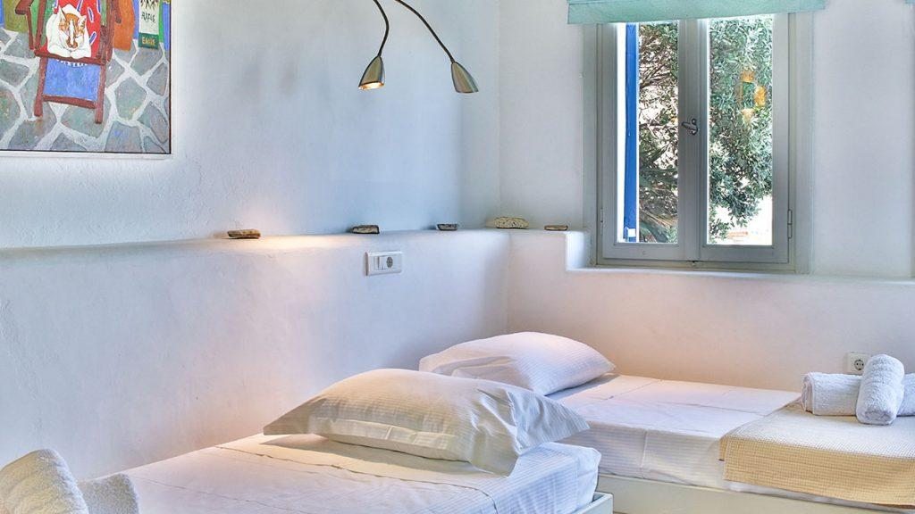 bedroom with two beds and lamp on the ceiling