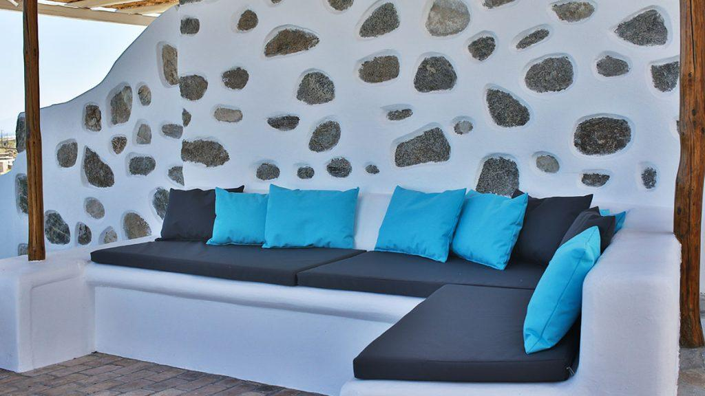 stone walls with comfort couch and soft pillows