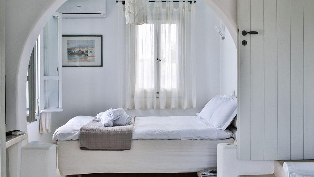Villa-Alastair_15.jpg Aleomandra Mykonos 1st Bedroom, bed, pillows, towels, curtains, air condition, door, stairs