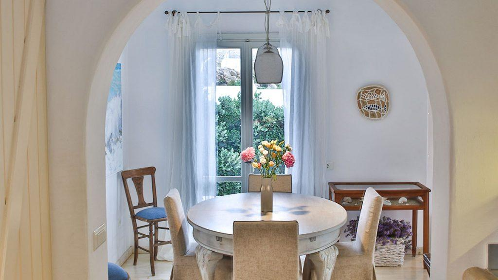 dining area with unique chandelier and beautiful round table