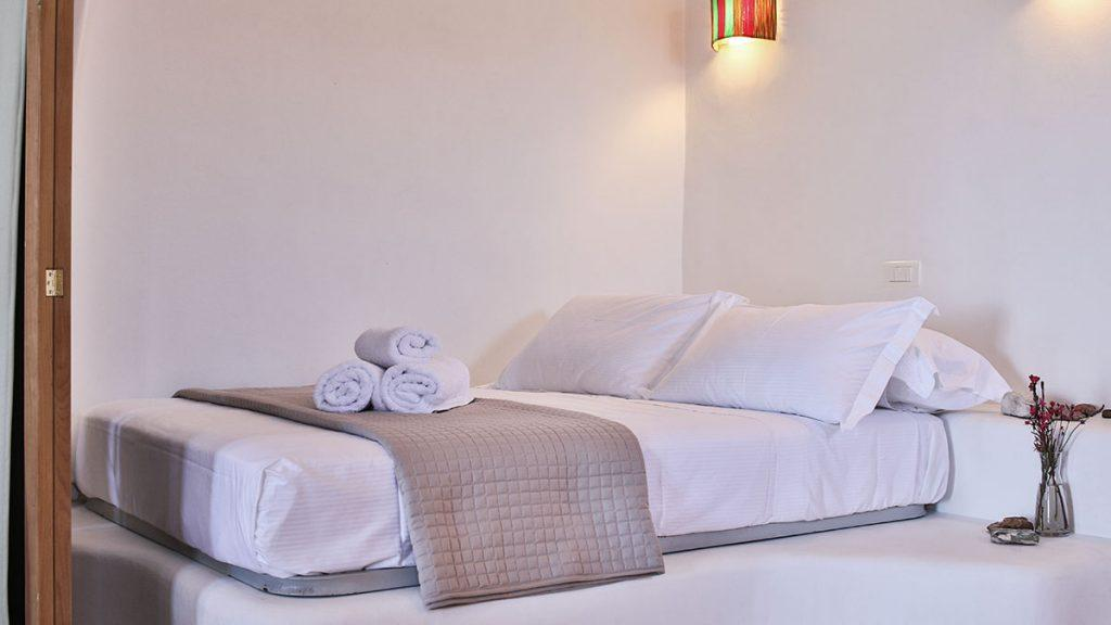 bedroom with wall lamp and comfortable bed