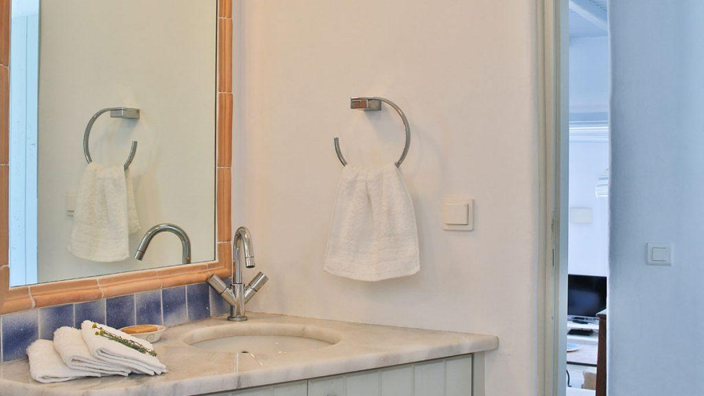 bathroom with towel rack and soft towels