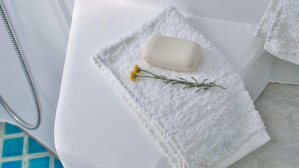bathroom with focus on soft towel and flower