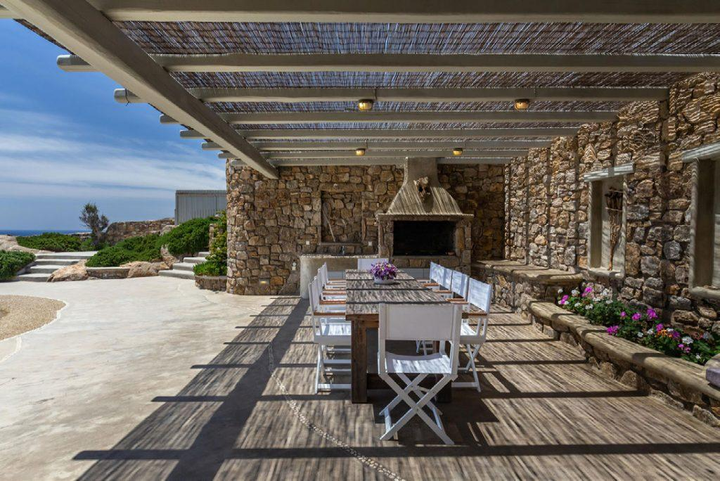 Villa-Camelia_15.jpg Agrari Mykonos, outdoor dining area, BBQ grill, dining table, chairs, flowers, vase