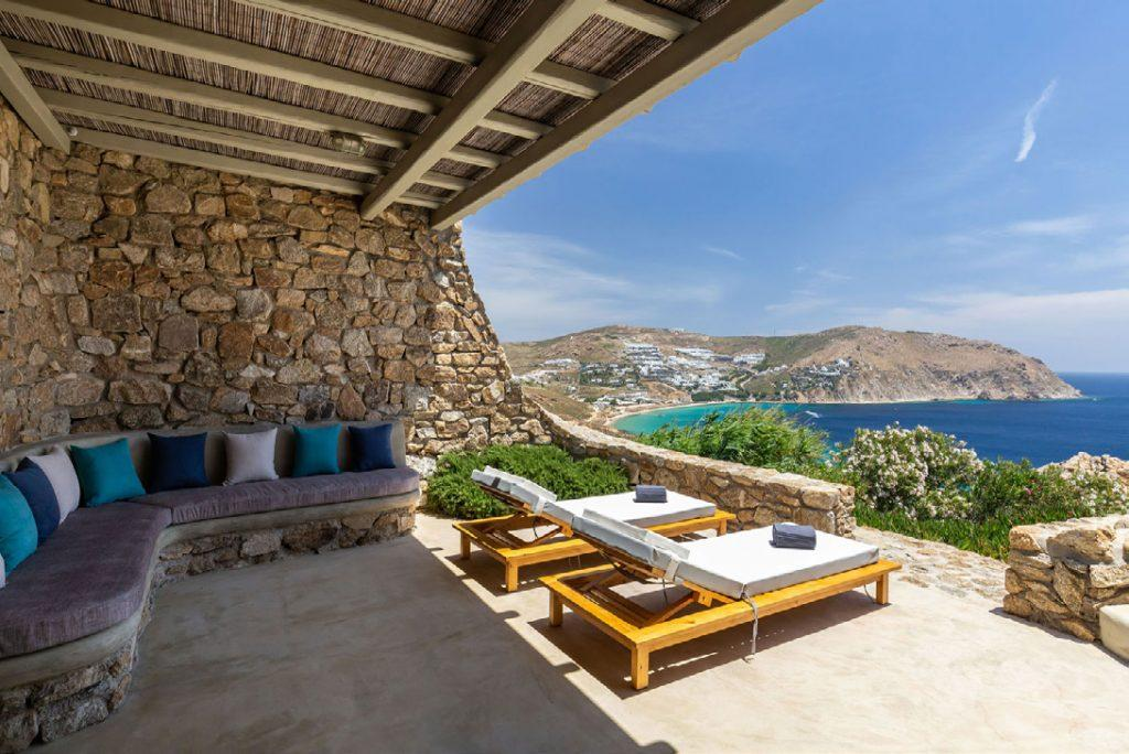 Villa-Camelia_17.jpg Agrari Mykonos, outdoor, climbers, towels, sofa, pillows, sea, sky