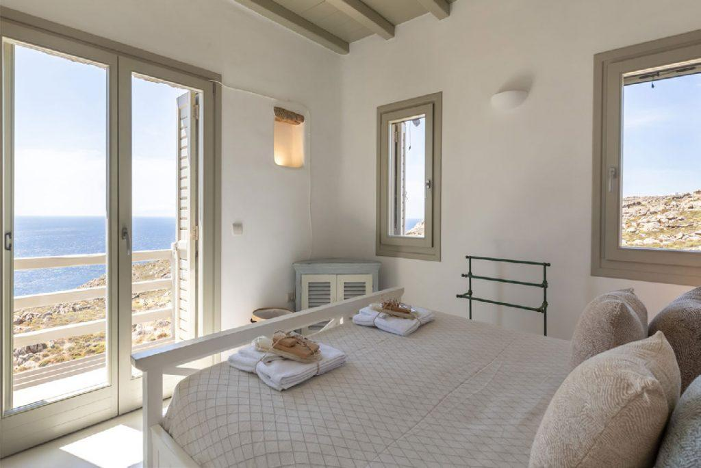 Villa-Camelia_25.jpg Agrari Mykonos, 3rd bedroom, king size bed, towels, pillows, windows, lamp, sea view