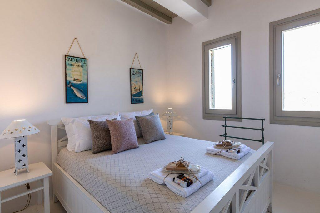 Villa-Camelia_27.jpg Agrari Mykonos, 3rd bedroom, king size bed, towels, paintings, nightstands, lamps, windows