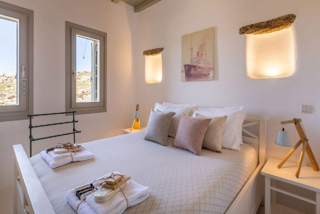 Villa-Camelia_29.jpg Agrari Mykonos, bedroom, bed, nightstands, painting, towel, windows