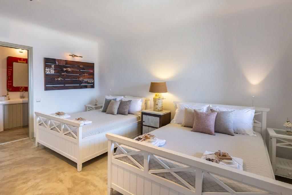 Villa-Camelia_33.jpg Agrari Mykonos, 4th bedroom, double bed, nightstands, lamp, painting, pillows, towels
