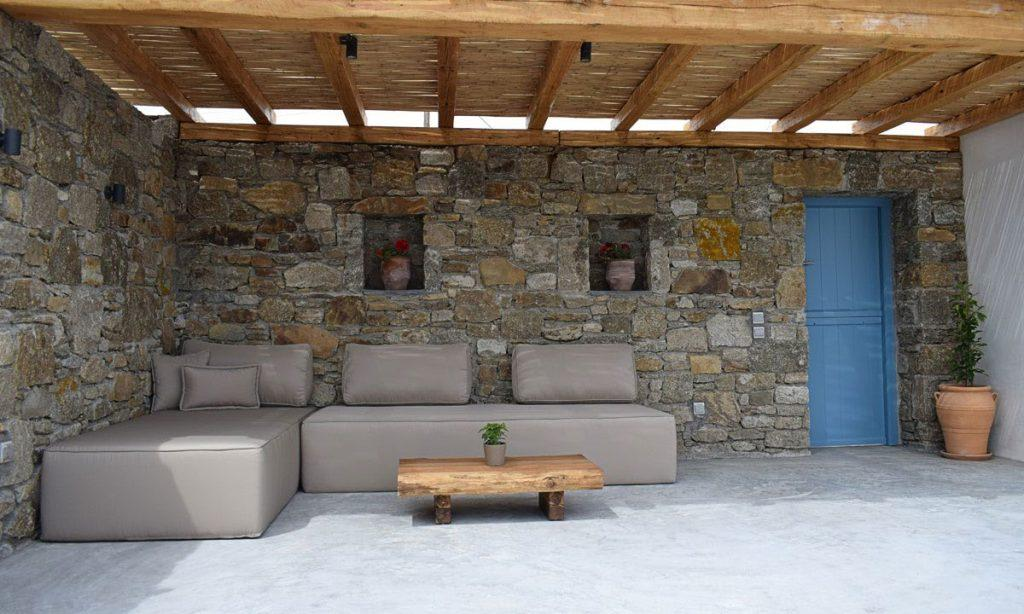 outdoor area with soft bed and wooden small table