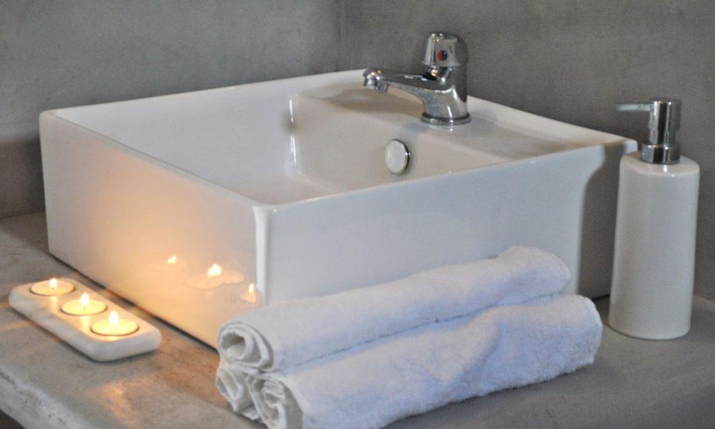 white sink and towels for cleaning