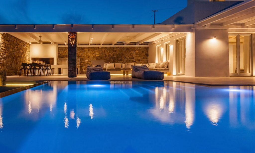 Villa-Paige-_05.jpg Elia Mykonos, outdoor, lights, night, pool, sun beds, sky