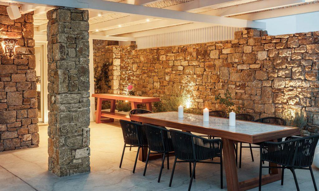 Villa-Paige-_22.jpg Elia Mykonos, outdoor, dining table, candles, stone wall, chairs