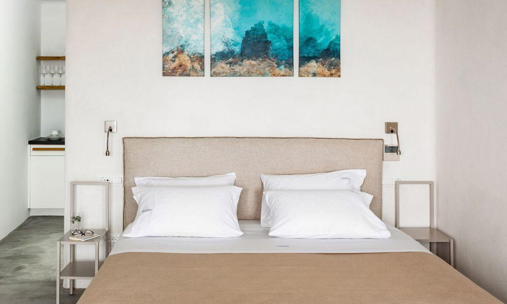 Villa-Paige-_31.jpg Elia Mykonos, 4th bedroom, king size bed, painting, nightstand, sunglasses, book, pillows
