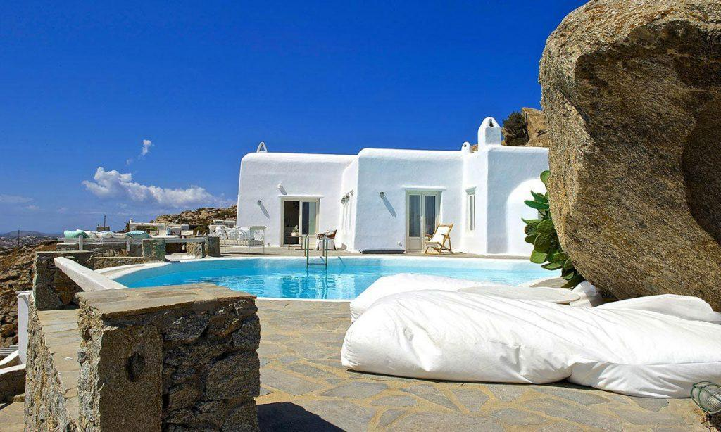 Villa-Ramsey-_04.jpg Halara Mykonos, outdoor, sun beds, pool, sky, villa exterior, chair