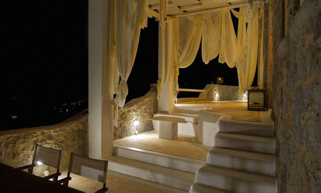 Villa-Ramsey-_11.jpg Halara Mykonos, outdoor, dining table, chairs, stairs, curtains, table