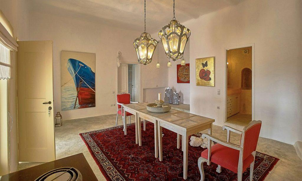 Villa-Ramsey-_19.jpg Halara Mykonos, dining room, dining table, chairs, paintings, carpet