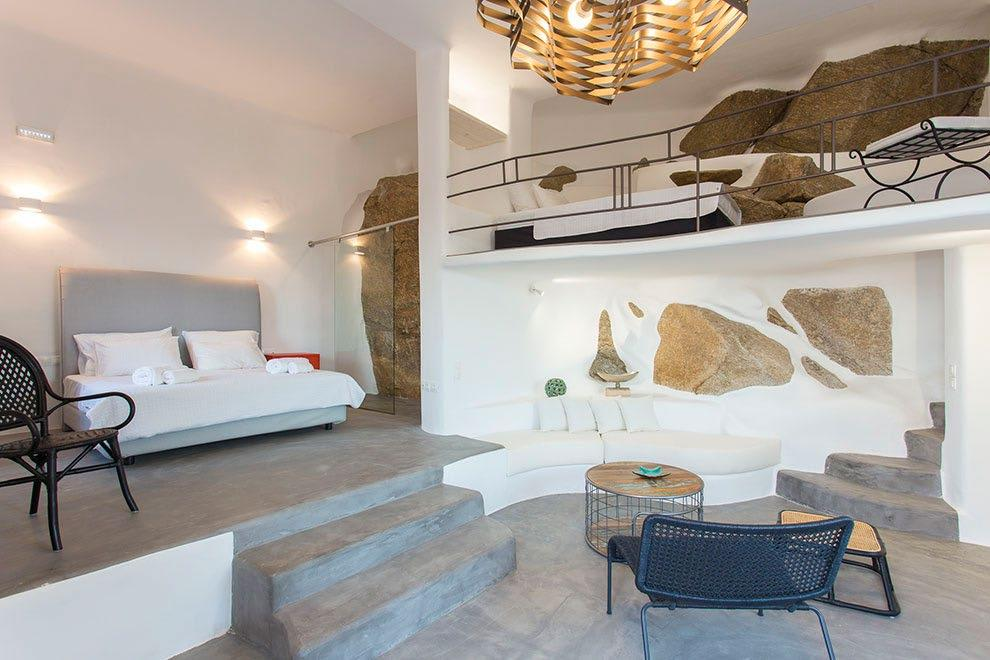 Villa-Ramsey-_22.jpg Halara Mykonos, 1st bedroom, king size bed, shower, towels, pillows, chairs, steps, chair, table, sofa