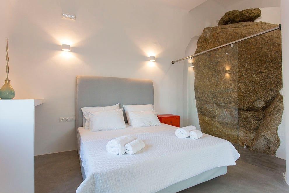 Villa-Ramsey-_23.jpg Halara Mykonos, 1st bedroom, shower, bed, pillows, robes, towels, nightstand