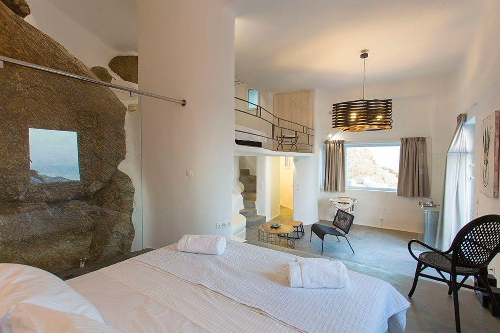 Villa-Ramsey-_28.jpg Halara Mykonos, 1st bedroom, shower, king size bed, towels, chairs, table, curtains, window, painting