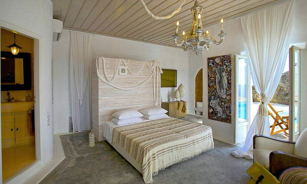 Villa-Ramsey-_32.jpg Halara Mykonos, 7th bedroom, king size bed, pillows, blanket, curtains, armchair, painting